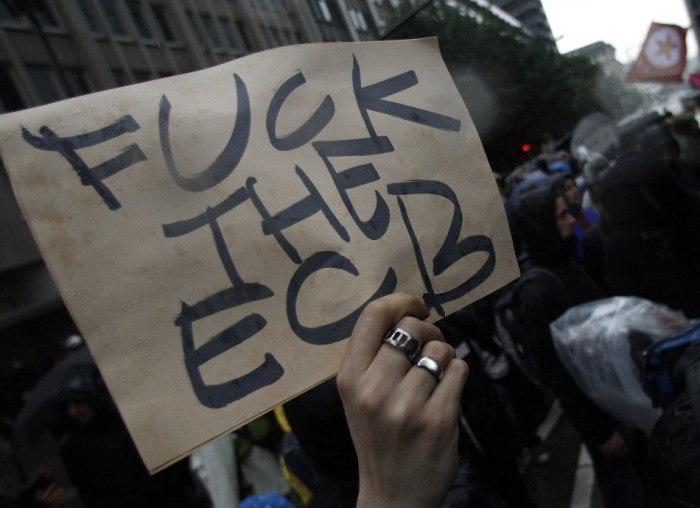 protester-holds-placard-during-anti-capitalist-blockupy-demonstration